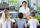 cheerful-woman-serving-food-schoolchildren_107420-44564-jpg_14-08-2020_14-53-01.jpg